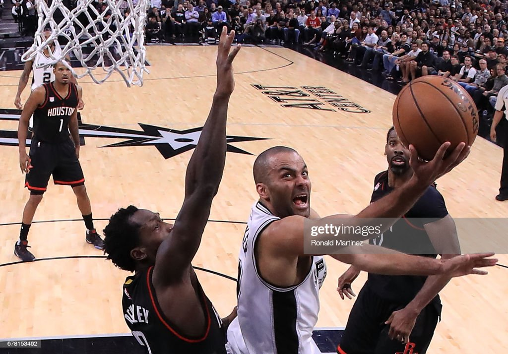 Tony Parker #9 of the San Antonio Spurs drives against Patrick Beverley #2 and Nene Hilario #42 of the Houston Rockets during Game Two of the NBA Western Conference Semi-Finals at AT&T Center on May 3, 2017 in San Antonio, Texas.