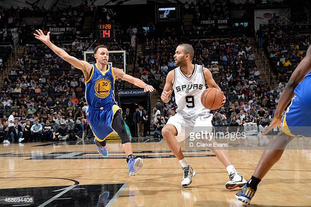Tony Parker of the San Antonio Spurs drives against Stephen Curry of the Golden State Warriors on April 5 2015 at the ATT Center in San Antonio Texas...