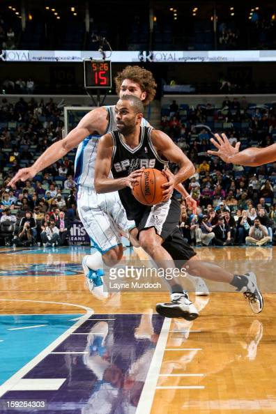 Tony Parker of the San Antonio Spurs drives against the New Orleans Hornets on January 7 2013 at the New Orleans Arena in New Orleans Louisiana NOTE...