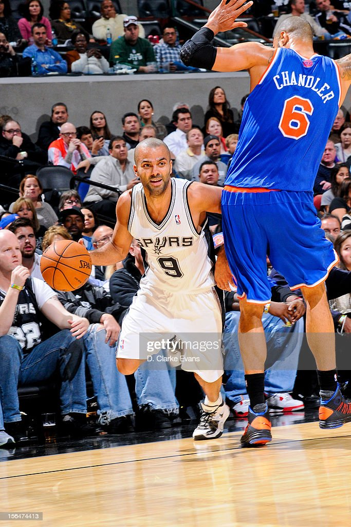 Tony Parker #9 of the San Antonio Spurs drives against <a gi-track='captionPersonalityLinkClicked' href=/galleries/search?phrase=Tyson+Chandler&family=editorial&specificpeople=202061 ng-click='$event.stopPropagation()'>Tyson Chandler</a> #6 of the New York Knicks on November 15, 2012 at the AT&T Center in San Antonio, Texas.