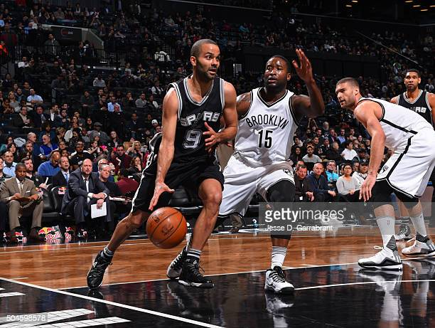 Tony Parker of the San Antonio Spurs drives baseline against the Brooklyn Nets on January 11 2015 at Barclays Center in Brooklyn New York NOTE TO...