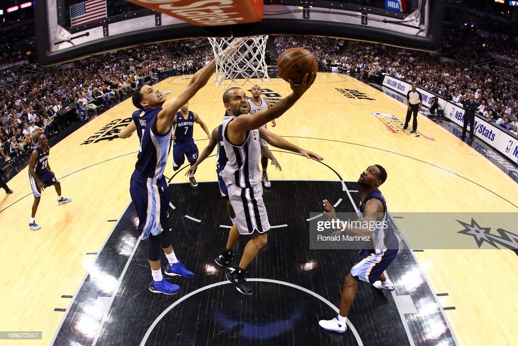 Tony Parker #9 of the San Antonio Spurs drives for a shot attempt against <a gi-track='captionPersonalityLinkClicked' href=/galleries/search?phrase=Austin+Daye&family=editorial&specificpeople=4682416 ng-click='$event.stopPropagation()'>Austin Daye</a> #5 (L) and <a gi-track='captionPersonalityLinkClicked' href=/galleries/search?phrase=Tony+Allen+-+Basketball+Player&family=editorial&specificpeople=201665 ng-click='$event.stopPropagation()'>Tony Allen</a> #9 of the Memphis Grizzlies during Game One of the Western Conference Finals of the 2013 NBA Playoffs at AT&T Center on May 19, 2013 in San Antonio, Texas.
