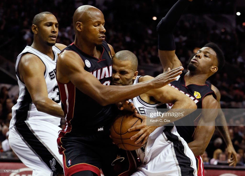 Tony Parker of the San Antonio Spurs drives in on Ray Allen and Norris Cole of the Miami Heat in the first half during Game Five of the 2013 NBA...