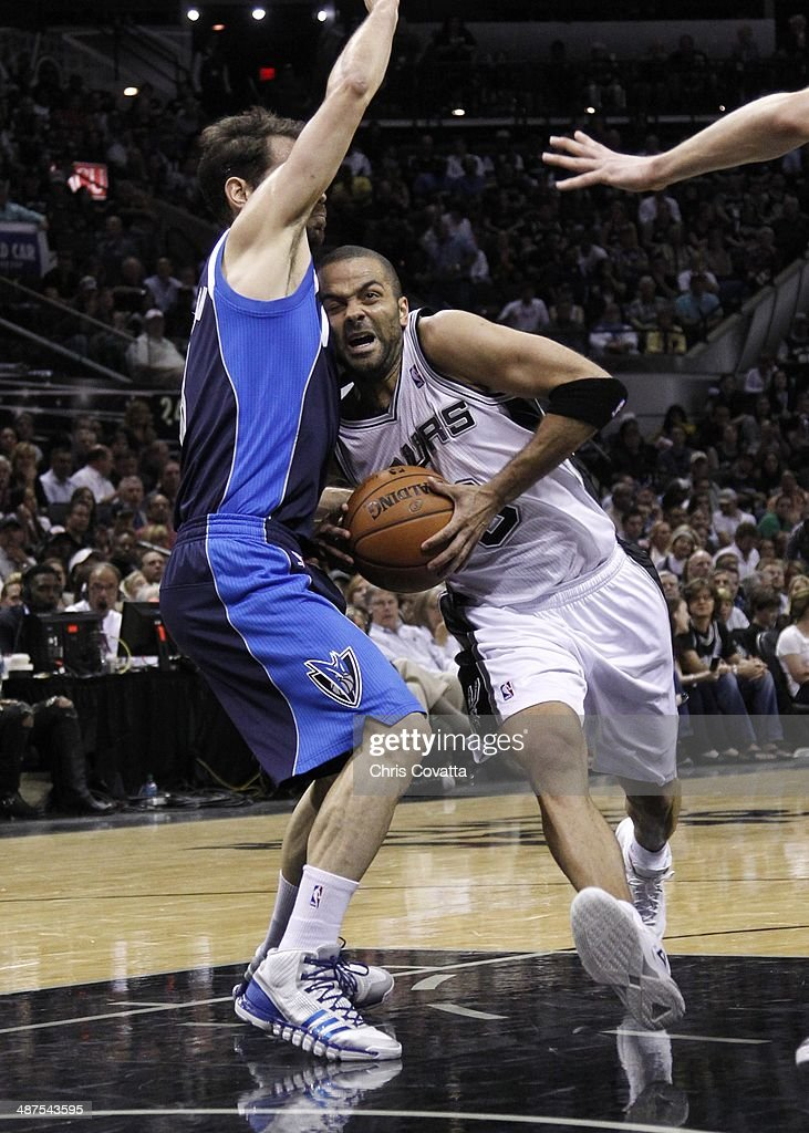 Tony Parker #9 of the San Antonio Spurs drives into the lane against <a gi-track='captionPersonalityLinkClicked' href=/galleries/search?phrase=Jose+Calderon&family=editorial&specificpeople=548297 ng-click='$event.stopPropagation()'>Jose Calderon</a> #8 of the Dallas Mavericks in Game Five of the Western Conference Quarterfinals during the 2014 NBA Playoffs at the AT&T Center on April 30, 2014 in San Antonio, Texas.
