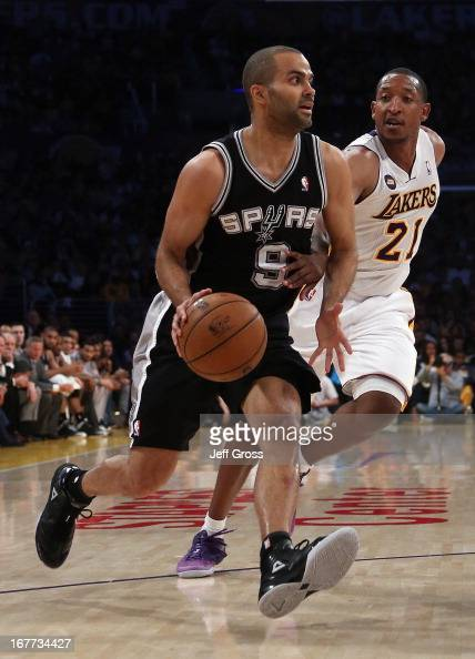 Tony Parker of the San Antonio Spurs drives past Chris Duhon of the Los Angeles Lakers in the first half during Game Four of the Western Conference...