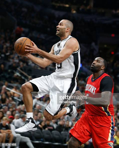 Tony Parker of the San Antonio Spurs drives past Kendrick Perkins of the New Orleans Pelicans at ATT Center on March 30 2016 in San Antonio Texas...