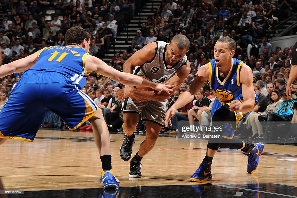 Tony Parker #9 of the San Antonio Spurs drives past <a gi-track='captionPersonalityLinkClicked' href=/galleries/search?phrase=Klay+Thompson&family=editorial&specificpeople=5132325 ng-click='$event.stopPropagation()'>Klay Thompson</a> #11 and Stephen Curry #30 of the Golden State Warriors in Game One of the Western Conference Semifinals during the 2013 NBA Playoffs on May 6, 2013 at the AT&T Center in San Antonio, Texas.