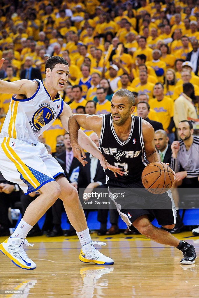 Tony Parker #9 of the San Antonio Spurs drives the baseline against Klay Thompson #11 of the Golden State Warriors in Game Six of the Western Conference Semifinals during the 2013 NBA Playoffs on May 16, 2013 at Oracle Arena in Oakland, California.
