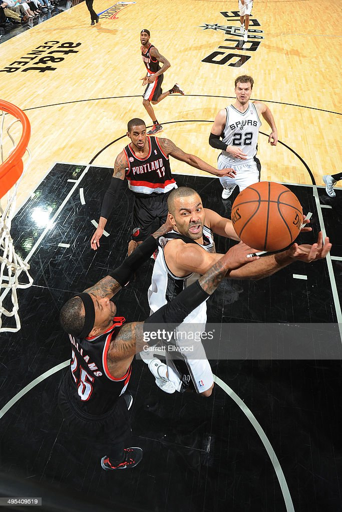 Tony Parker #9 of the San Antonio Spurs drives to the basket against Mo Williams #25 of the Portland Trail Blazers in Game One of the Western Conference Semifinals during the 2014 NBA Playoffs on May 6, 2014 at the AT&T Center in San Antonio, Texas.