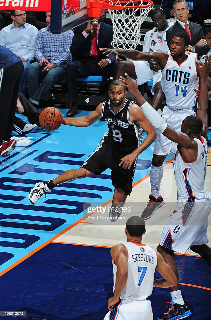 Tony Parker #9 of the San Antonio Spurs drives to the basket against of the Charlotte Bobcats at Time Warner Cable Arena on December 8, 2012 in Charlotte, North Carolina.