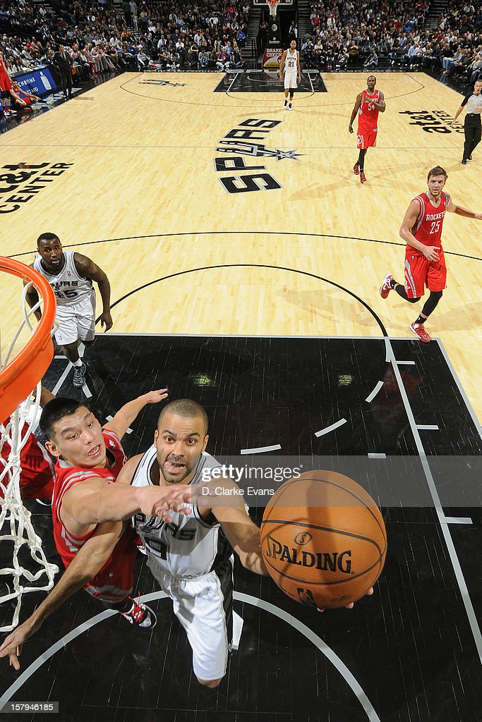 Tony Parker #9 of the San Antonio Spurs drives to the basket against <a gi-track='captionPersonalityLinkClicked' href=/galleries/search?phrase=Jeremy+Lin&family=editorial&specificpeople=6669516 ng-click='$event.stopPropagation()'>Jeremy Lin</a> #7 of the Houston Rockets on December 7, 2012 at the AT&T Center in San Antonio, Texas.