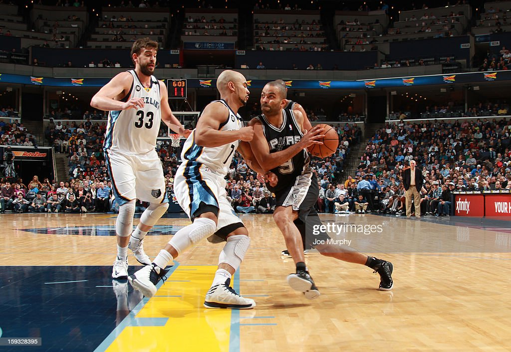 Tony Parker #9 of the San Antonio Spurs drives to the basket against Jerryd Bayless #7 of the Memphis Grizzlies on January 11, 2013 at FedExForum in Memphis, Tennessee.