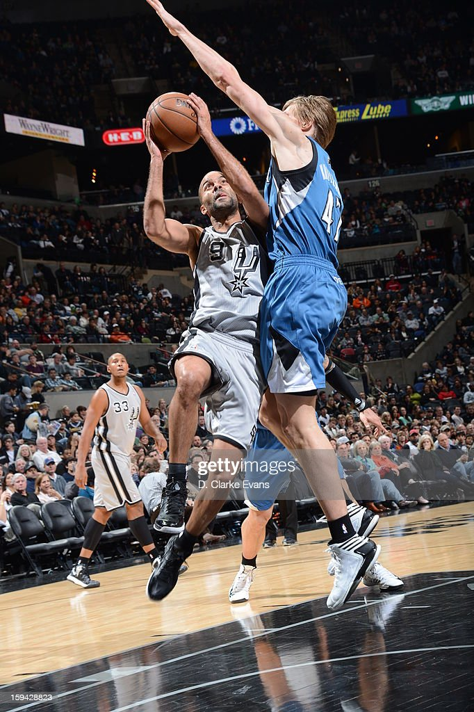 Tony Parker #9 of the San Antonio Spurs drives to the basket against <a gi-track='captionPersonalityLinkClicked' href=/galleries/search?phrase=Andrei+Kirilenko&family=editorial&specificpeople=201909 ng-click='$event.stopPropagation()'>Andrei Kirilenko</a> #47 of the Minnesota Timberwolves on January 13, 2013 at the AT&T Center in San Antonio, Texas.