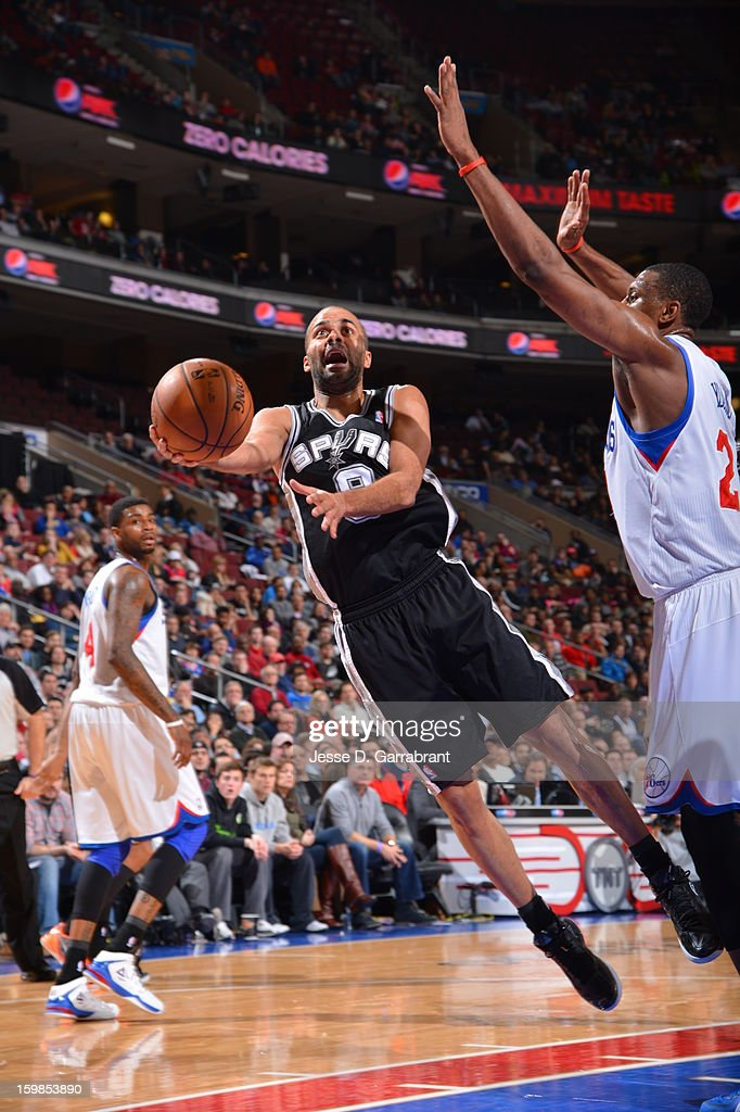 Tony Parker #9 of the San Antonio Spurs drives to the basket against <a gi-track='captionPersonalityLinkClicked' href=/galleries/search?phrase=Thaddeus+Young&family=editorial&specificpeople=3847270 ng-click='$event.stopPropagation()'>Thaddeus Young</a> #21 of the Philadelphia 76ers during the game at the Wells Fargo Center on January 21, 2013 in Philadelphia, Pennsylvania.