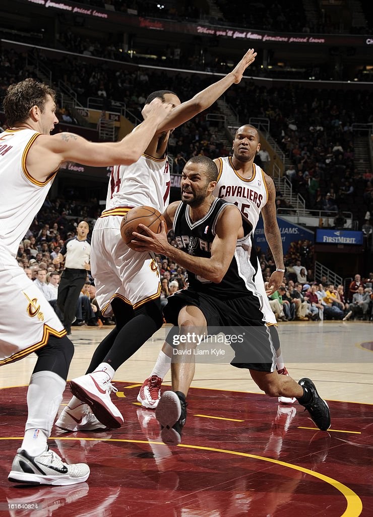 Tony Parker #9 of the San Antonio Spurs drives to the basket against Shaun Livingston #14 of the Cleveland Cavaliers at The Quicken Loans Arena on February 13, 2013 in Cleveland, Ohio.