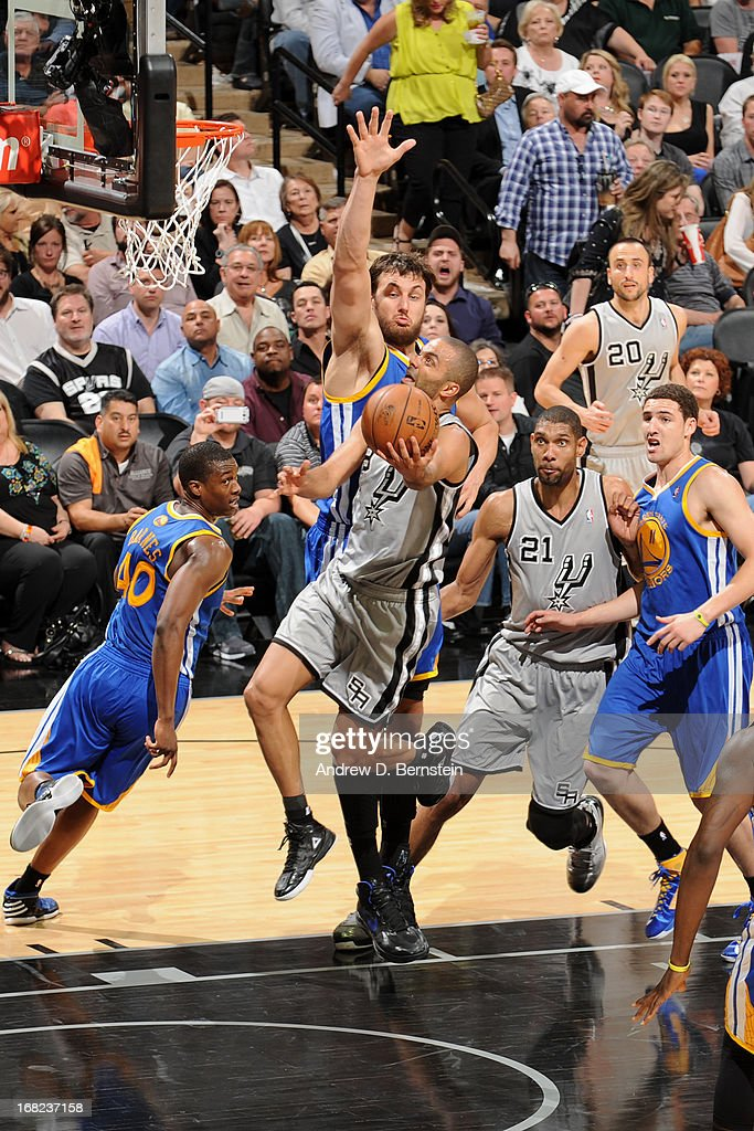 Tony Parker #9 of the San Antonio Spurs drives to the basket against Andrew Bogut #12 of the Golden State Warriors in Game One of the Western Conference Semifinals during the 2013 NBA Playoffs on May 6, 2013 at the AT&T Center in San Antonio, Texas.
