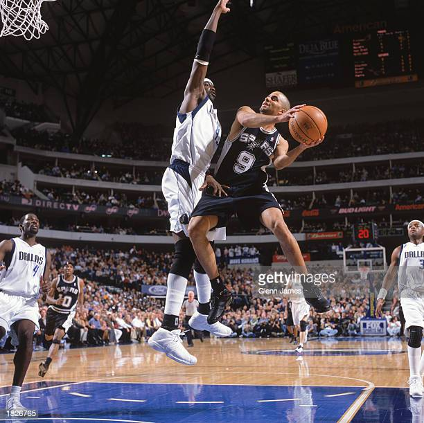 Tony Parker of the San Antonio Spurs drives to the basket against Walt Williams of the Dallas Mavericks at American Airlines Arena on February 20...