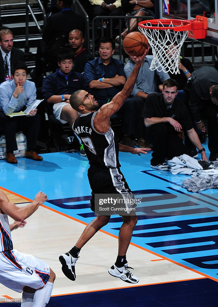 Tony Parker #9 of the San Antonio Spurs drives to the basket against the Charlotte Bobcats at Time Warner Cable Arena on December 8, 2012 in Charlotte, North Carolina.