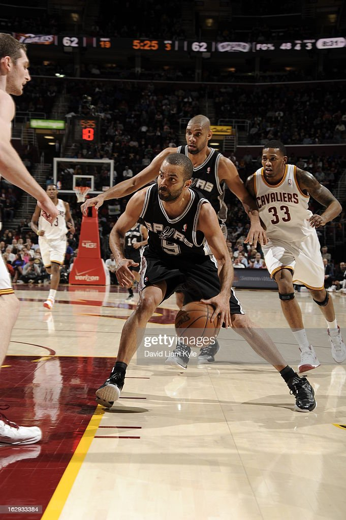 Tony Parker #9 of the San Antonio Spurs drives to the basket against the Cleveland Cavaliers at The Quicken Loans Arena on February 13, 2013 in Cleveland, Ohio.