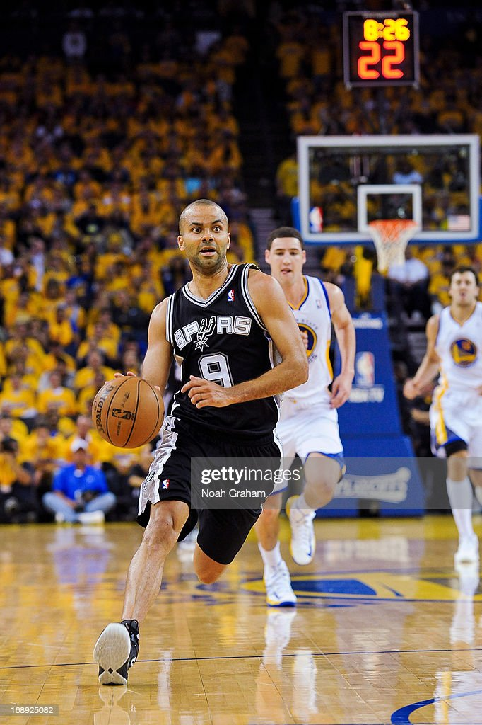 Tony Parker #9 of the San Antonio Spurs drives to the basket against the Golden State Warriors in Game Six of the Western Conference Semifinals during the 2013 NBA Playoffs on May 16, 2013 at Oracle Arena in Oakland, California.