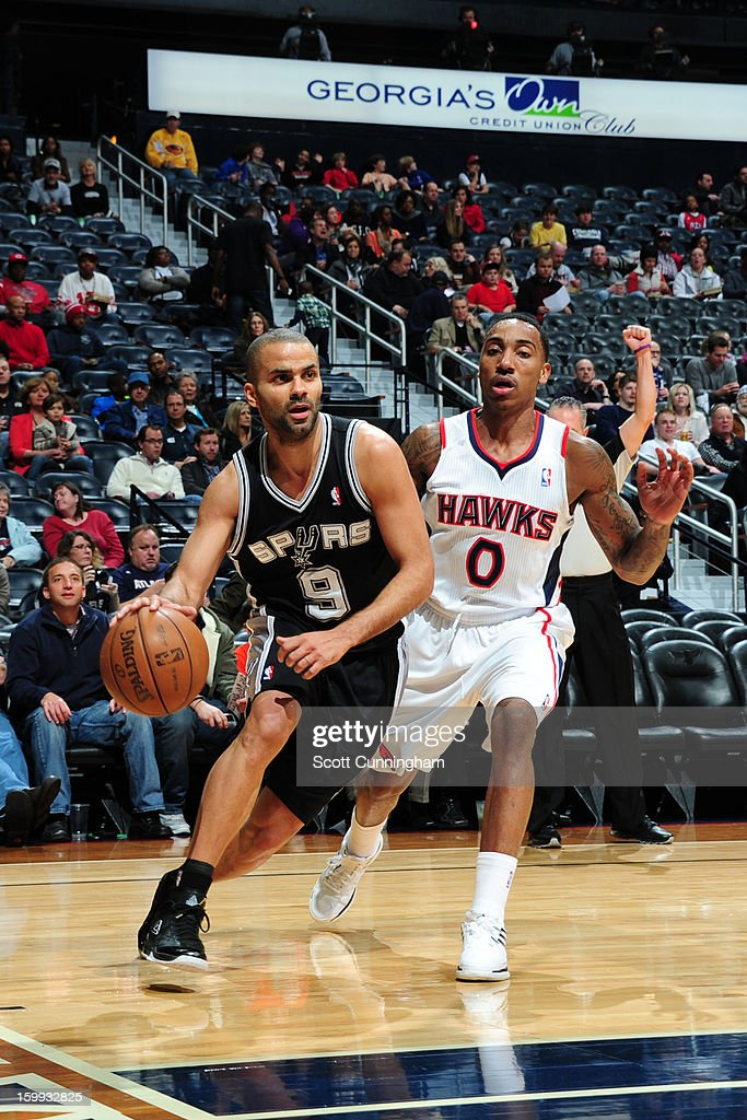 Tony Parker #9 of the San Antonio Spurs drives to the basket around <a gi-track='captionPersonalityLinkClicked' href=/galleries/search?phrase=Jeff+Teague&family=editorial&specificpeople=4680498 ng-click='$event.stopPropagation()'>Jeff Teague</a> #0 of the Atlanta Hawks on January 19, 2013 at Philips Arena in Atlanta, Georgia.