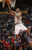 Tony Parker of the San Antonio Spurs drives to the basket for a dunk during the The Got Milk Rookie Challenge at the 2003 NBA All Star Weekend at...