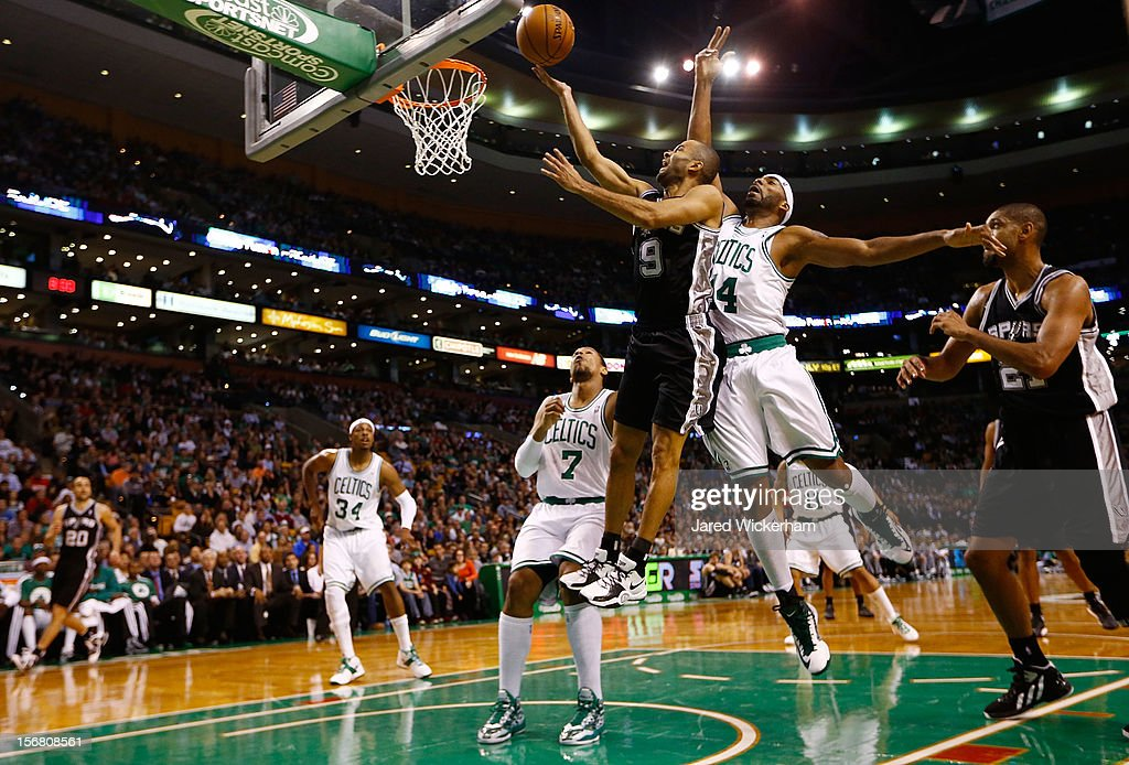 Tony Parker #9 of the San Antonio Spurs drives to the basket for a layup in front of Chris Wilcox #44 of the Boston Celtics during the game on November 21, 2012 at TD Garden in Boston, Massachusetts.