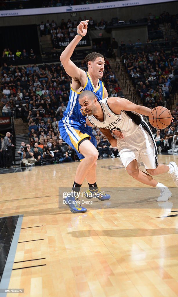 Tony Parker #9 of the San Antonio Spurs drives to the basket in a game against the Golden State Warriors on January 18, 2013 at the AT&T Center in San Antonio, Texas.
