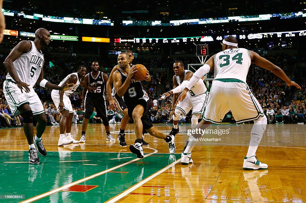 Tony Parker #9 of the San Antonio Spurs drives to the basket past in between Kevin Garnett #5 and Paul Pierce #34 of the Boston Celtics during the game on November 21, 2012 at TD Garden in Boston, Massachusetts.