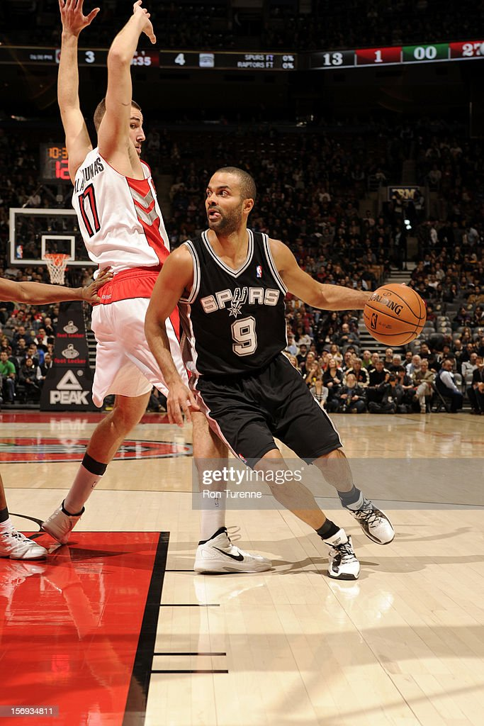 Tony Parker #9 of the San Antonio Spurs drives to the basket vs the Toronto Raptors during the game on November 25, 2012 at the Air Canada Centre in Toronto, Ontario, Canada.
