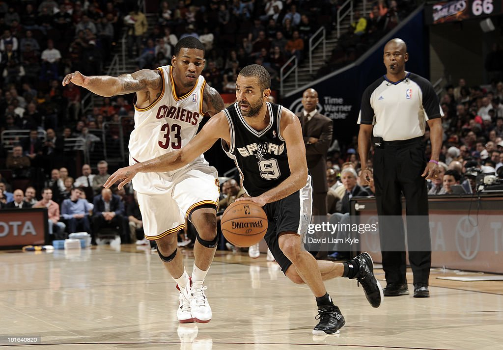 Tony Parker #9 of the San Antonio Spurs drives to the hoop against Alonzo Gee #33 of the Cleveland Cavaliers at The Quicken Loans Arena on February 13, 2013 in Cleveland, Ohio.