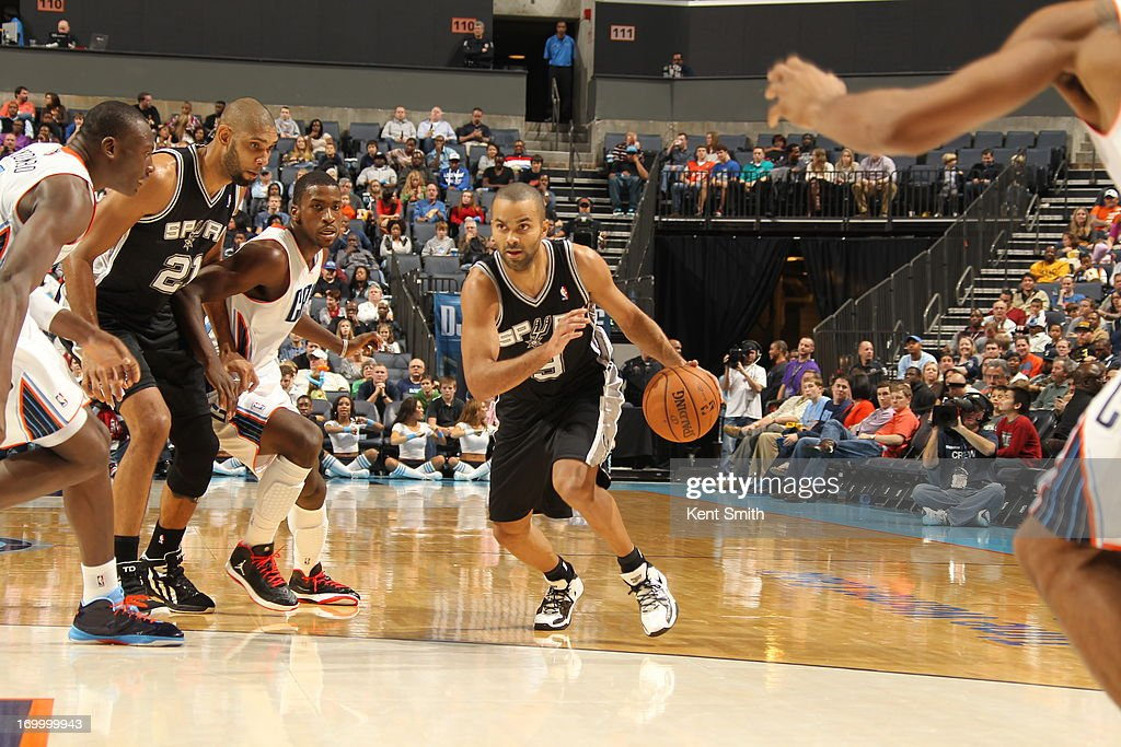 Tony Parker #9 of the San Antonio Spurs drives to the hoop against the Charlotte Bobcats at the Time Warner Cable Arena on December 8, 2012 in Charlotte, North Carolina.