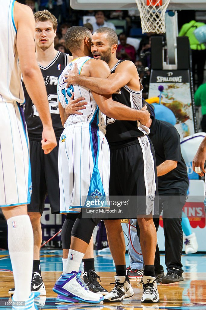 Tony Parker #9 of the San Antonio Spurs embraces Eric Gordon #10 of the New Orleans Hornets before their game on January 7, 2013 at the New Orleans Arena in New Orleans, Louisiana.