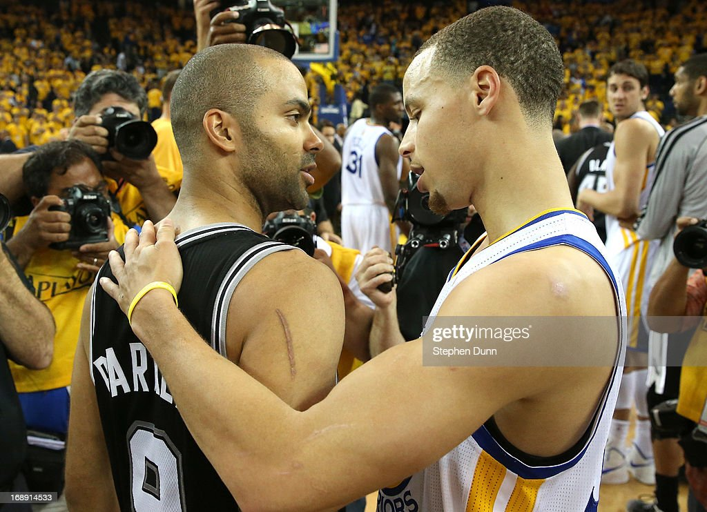 Tony Parker #9 of the San Antonio Spurs embraces Stephen Curry #30 of the Golden State Warriors after Game Six of the Western Conference Semifinals during the 2013 NBA Playoffs on May 16, 2013 at the Oracle Arena in Oakland, California. The Spurs won 94-82 to take the series 4-2. .