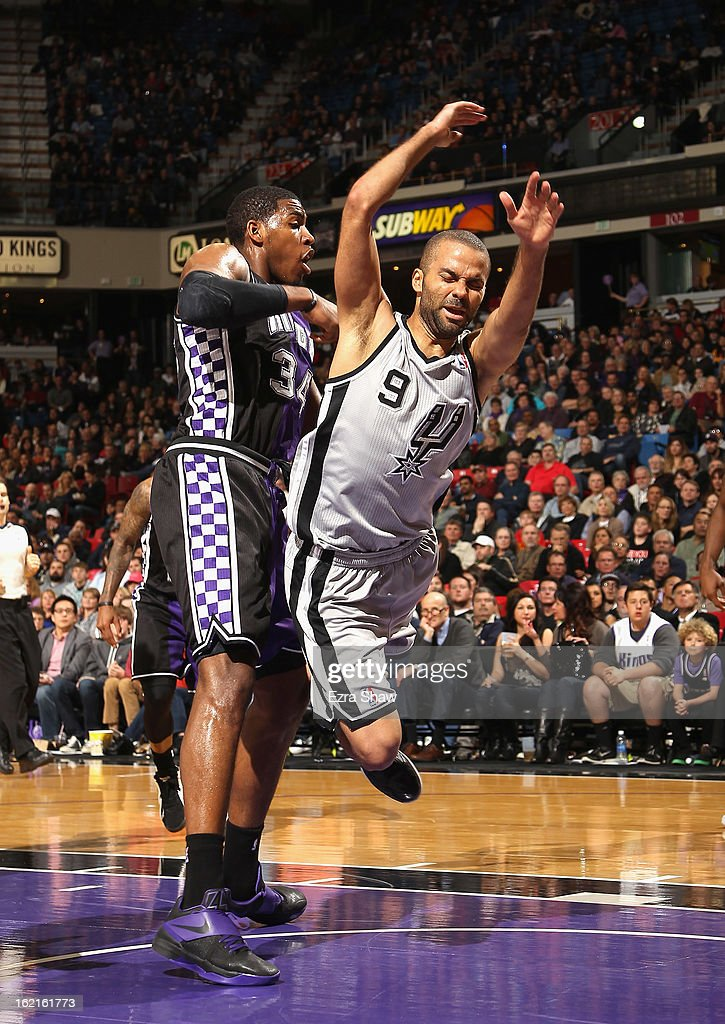 Tony Parker #9 of the San Antonio Spurs falls to the crowd after colliding with Jason Thompson #34 of the Sacramento Kings at Sleep Train Arena on February 19, 2013 in Sacramento, California.