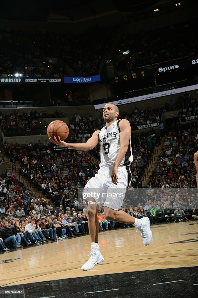 <a gi-track='captionPersonalityLinkClicked' href=/galleries/search?phrase=Tony+Parker&family=editorial&specificpeople=160952 ng-click='$event.stopPropagation()'>Tony Parker</a> #9 of the San Antonio Spurs finger rolls the ball in a game against the Golden State Warriors on January 18, 2013 at the AT&T Center in San Antonio, Texas.