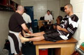 Tony Parker of the San Antonio Spurs gets taped up while in the locker room prior to practice between games three and four of the 2003 NBA Finals...
