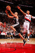 Tony Parker of the San Antonio Spurs goes for the layup against Damian Lillard of the Portland Trail Blazers during the game on November 11 2015 at...