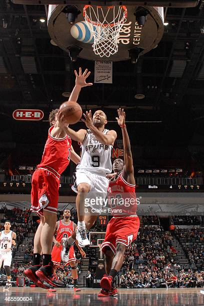 Tony Parker of the San Antonio Spurs goes for the layup against the Chicago Bulls during the game on March 8 2015 at ATT Center in San Antonio Texas...