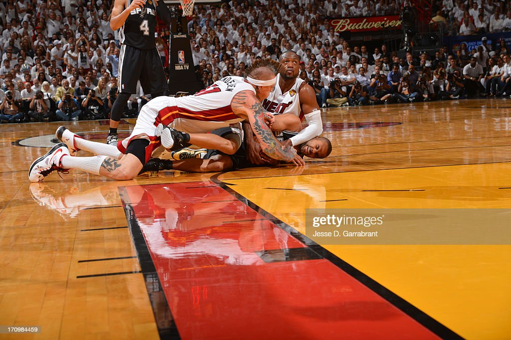 Tony Parker #9 of the San Antonio Spurs goes for the loose ball against Chris Andersen #11 and Dwyane Wade #3 of the Miami Heat during Game Seven of the 2013 NBA Finals on June 20, 2013 at American Airlines Arena in Miami, Florida.