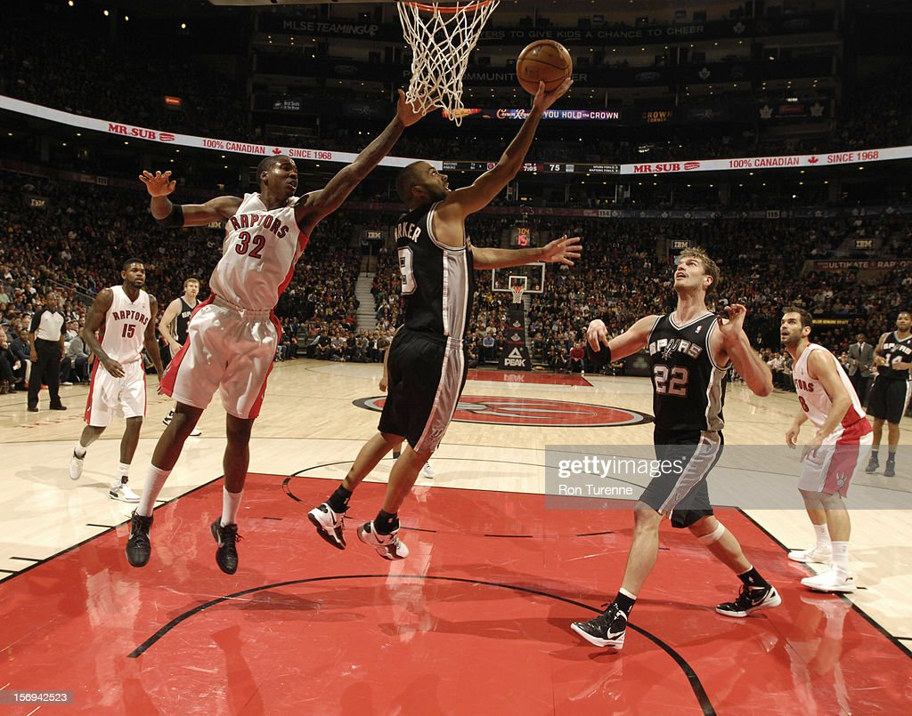 Tony Parker #9 of the San Antonio Spurs goes in for the reverse layup vs the Toronto Raptors during the game on November 25, 2012 at the Air Canada Centre in Toronto, Ontario, Canada.