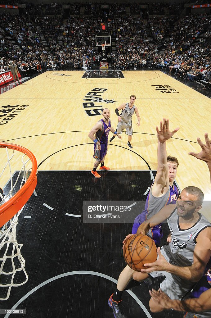 Tony Parker #9 of the San Antonio Spurs goes to the basket against <a gi-track='captionPersonalityLinkClicked' href=/galleries/search?phrase=Goran+Dragic&family=editorial&specificpeople=4452965 ng-click='$event.stopPropagation()'>Goran Dragic</a> #1 of the Phoenix Suns on January 26, 2013 at the AT&T Center in San Antonio, Texas.