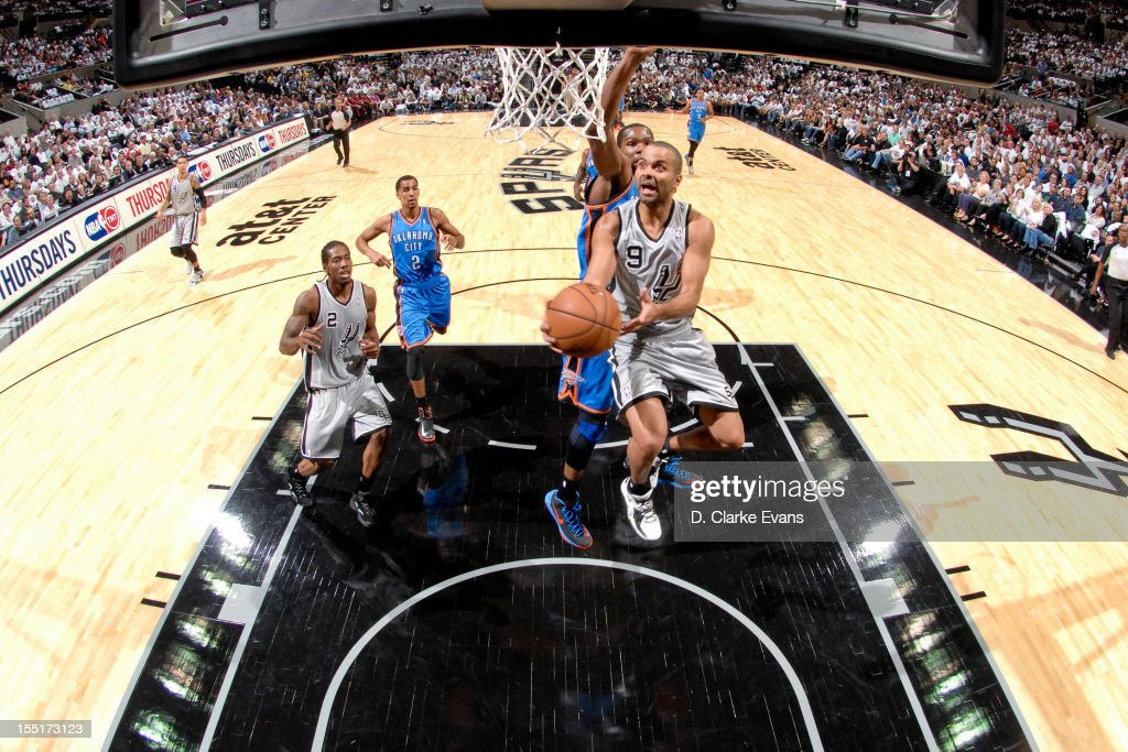Tony Parker #9 of the San Antonio Spurs goes to the basket against <a gi-track='captionPersonalityLinkClicked' href=/galleries/search?phrase=Kevin+Durant&family=editorial&specificpeople=3847329 ng-click='$event.stopPropagation()'>Kevin Durant</a> #35 of the Oklahoma City Thunder on November 1, 2012 at the AT&T Center in San Antonio, Texas.