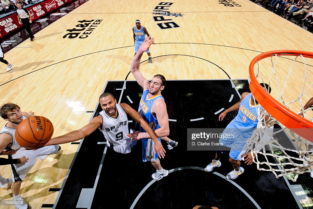 Tony Parker #9 of the San Antonio Spurs goes to the basket against <a gi-track='captionPersonalityLinkClicked' href=/galleries/search?phrase=Kosta+Koufos&family=editorial&specificpeople=4216032 ng-click='$event.stopPropagation()'>Kosta Koufos</a> #41 of the Denver Nuggets during a pre-season game on October 12, 2012 at the AT&T Center in San Antonio, Texas.
