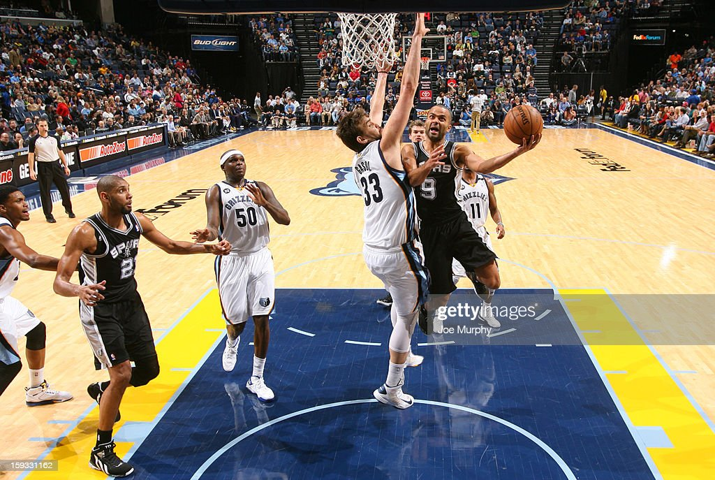 Tony Parker #9 of the San Antonio Spurs goes to the basket against <a gi-track='captionPersonalityLinkClicked' href=/galleries/search?phrase=Marc+Gasol&family=editorial&specificpeople=661205 ng-click='$event.stopPropagation()'>Marc Gasol</a> #33 of the Memphis Grizzlies on January 11, 2013 at FedExForum in Memphis, Tennessee.