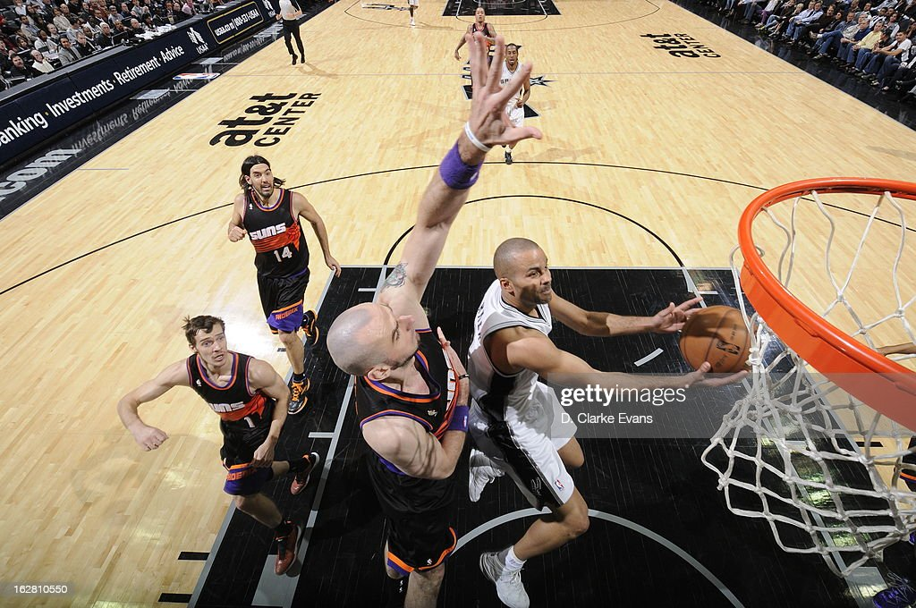 Tony Parker #9 of the San Antonio Spurs goes to the basket against <a gi-track='captionPersonalityLinkClicked' href=/galleries/search?phrase=Marcin+Gortat&family=editorial&specificpeople=589986 ng-click='$event.stopPropagation()'>Marcin Gortat</a> #4 of the Phoenix Suns on February 27, 2013 at the AT&T Center in San Antonio, Texas.