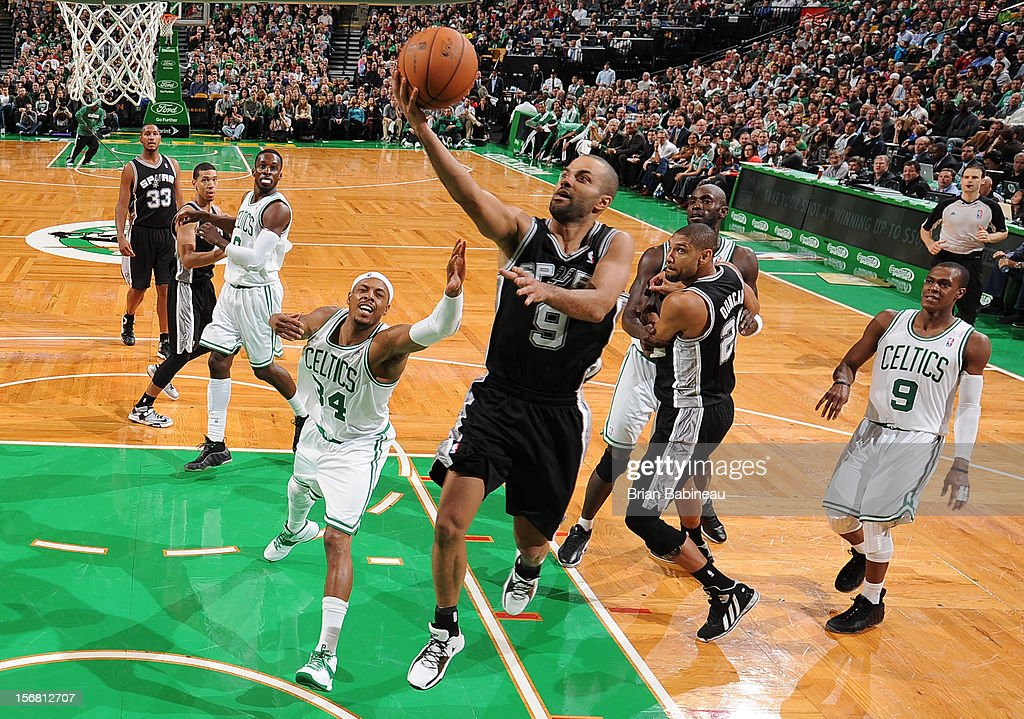 Tony Parker #9 of the San Antonio Spurs goes to the basket against Paul Pierce #34 of the Boston Celtics on November 21, 2012 at the TD Garden in Boston, Massachusetts.