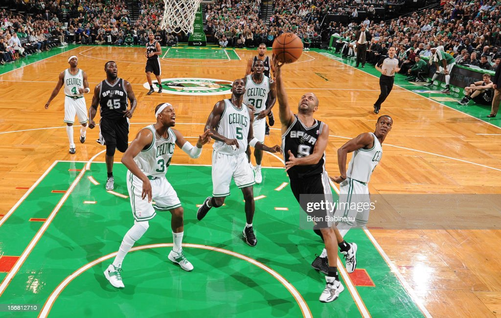 Tony Parker #9 of the San Antonio Spurs goes to the basket against Rajon Rondo #9 of the Boston Celtics on November 21, 2012 at the TD Garden in Boston, Massachusetts.