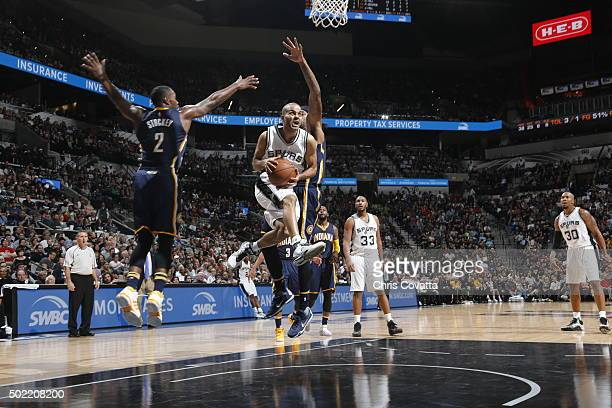 Tony Parker of the San Antonio Spurs goes to the basket against the Indiana Pacers on December 21 2015 at the ATT Center in San Antonio Texas NOTE TO...