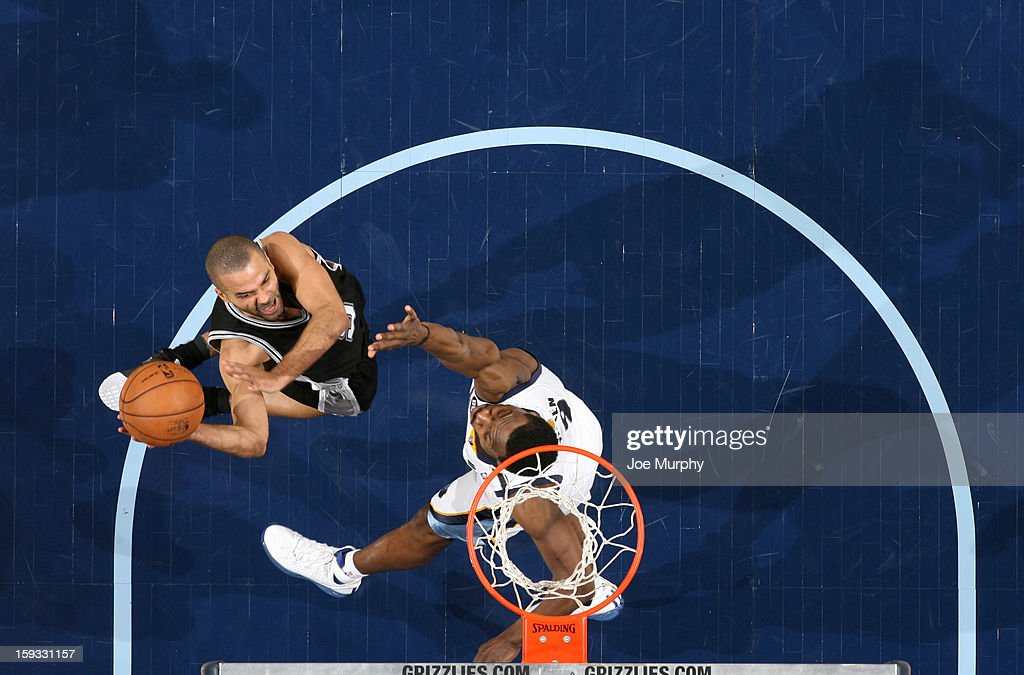 Tony Parker #9 of the San Antonio Spurs goes to the basket against <a gi-track='captionPersonalityLinkClicked' href=/galleries/search?phrase=Tony+Allen+-+Basketball+Player&family=editorial&specificpeople=201665 ng-click='$event.stopPropagation()'>Tony Allen</a> #9 of the Memphis Grizzlies on January 11, 2013 at FedExForum in Memphis, Tennessee.